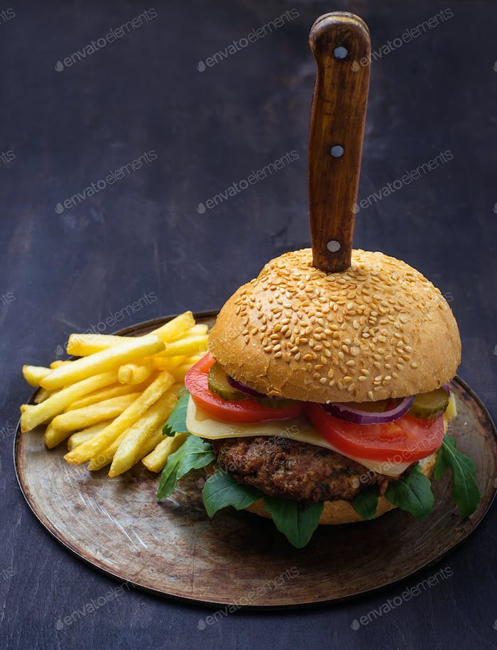 Burger with cutlet, tomato, cheese and french fries