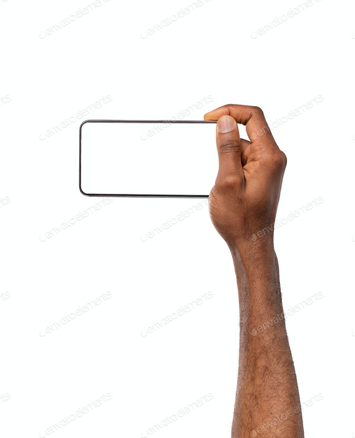 Afro man's hand holding smartphone with blank screen, watching videos