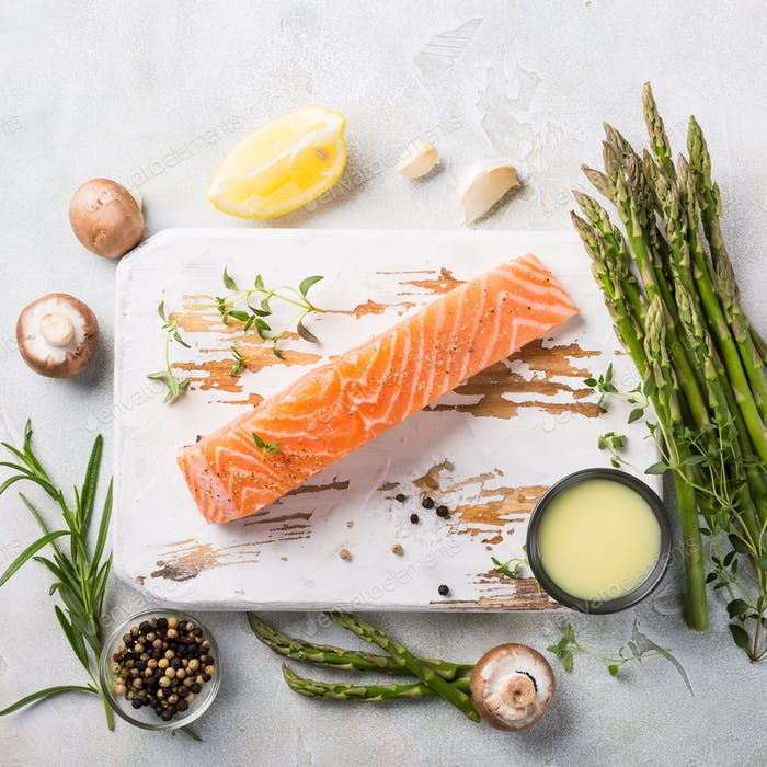 fresh green asparagus and raw salmon fillet