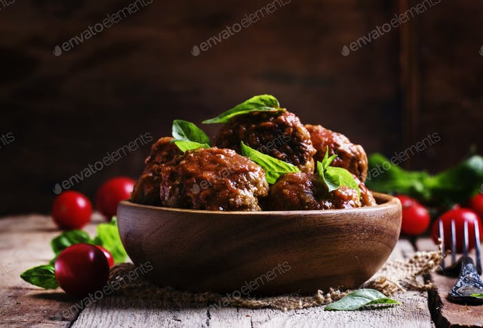 Meatballs of pork and beef with spicy tomato sauce in bowl