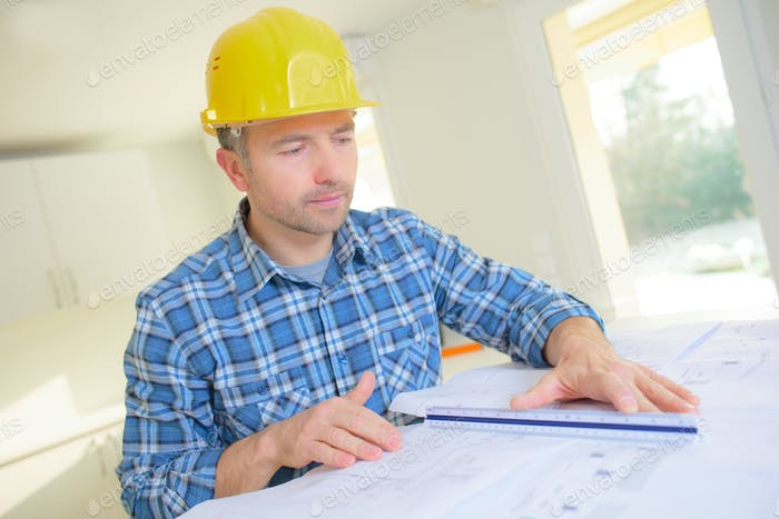 architect sketching a construction project