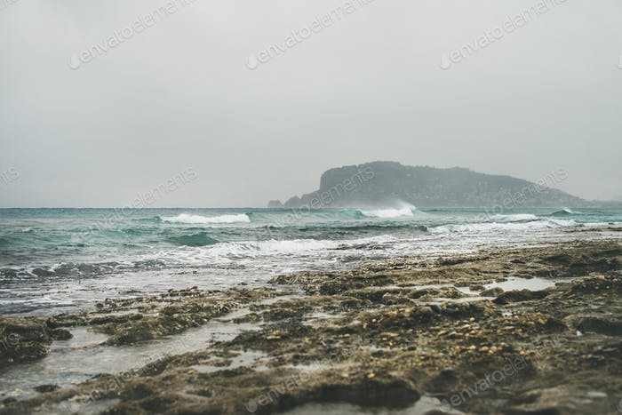 Stormy winter day at Mediterranean sea coast in Alanya, Turkey