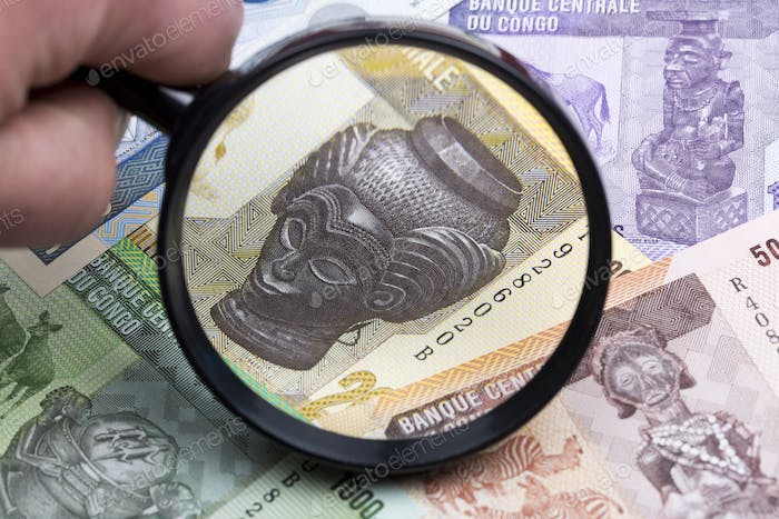 Congolese franc in a magnifying glass