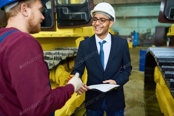 Smiling Young Businessman at Plant