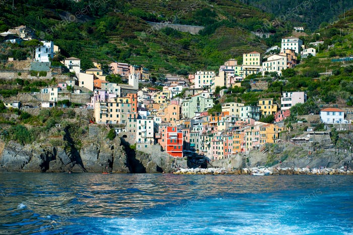 View of Riomaggiore, Italy from the sea with wake
