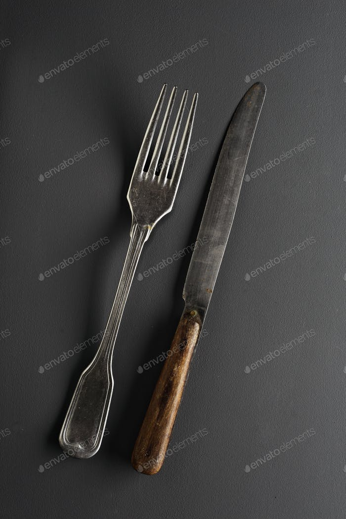 old cutlery fork and knife  on gray background