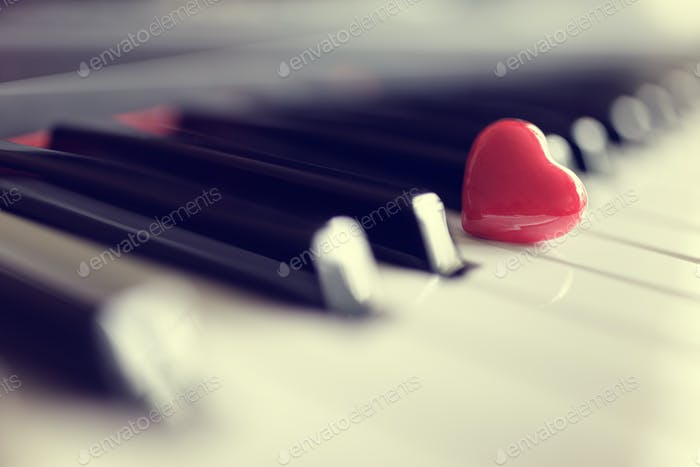 Red heart on piano keys