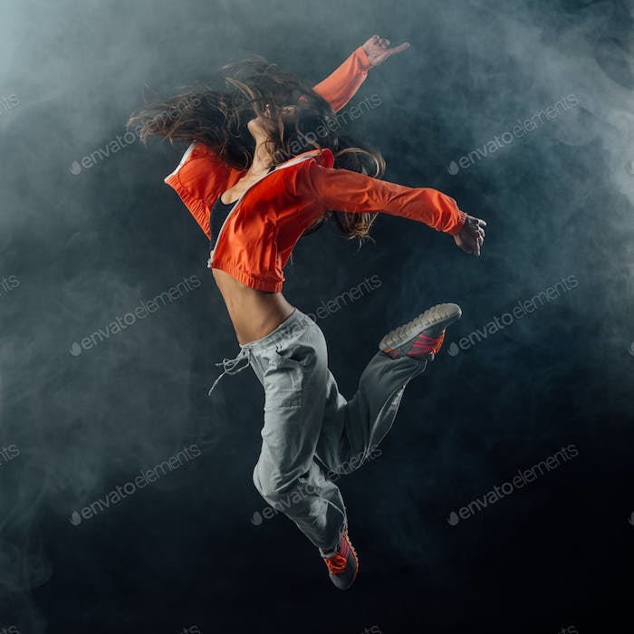 Performer dancing on dark background