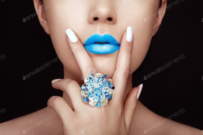 Beauty girl face close up with blue lips