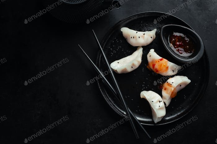 Asian dumplings served on plate