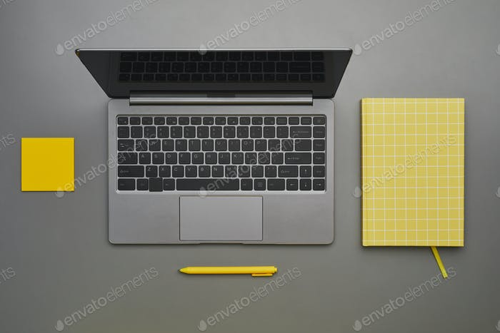 Graphic Workplace and Laptop Flat Lay