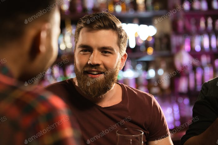 Close up of a two male friends drinking draft beer