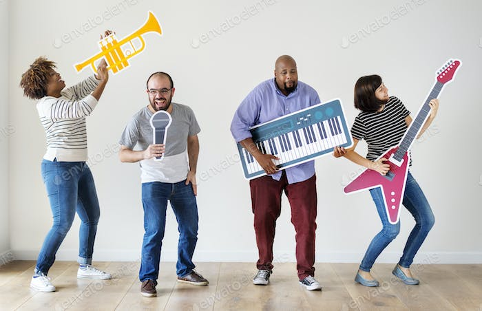 Group of diverse people enjoying music instruments