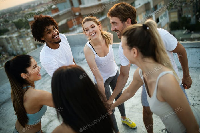 Fitness, sport, training and healthy lifestyle concept - group of happy people exercising outdoor