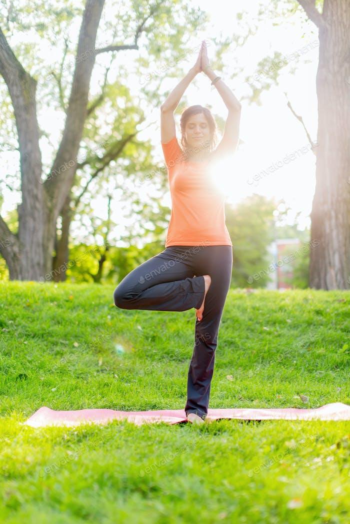 girl meditating and doing yoga at sunset