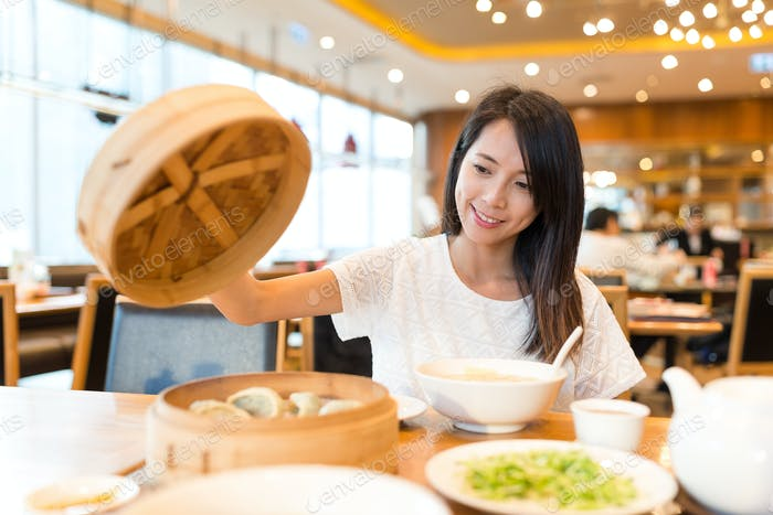 Young Woman enjoy meal in chinese restaurant
