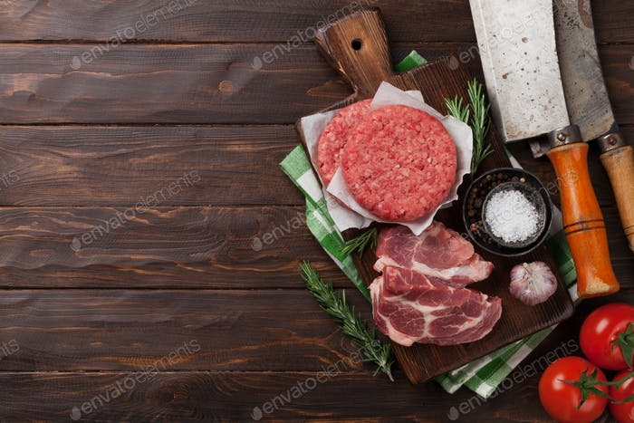 Raw minced meat and ingredients for burgers