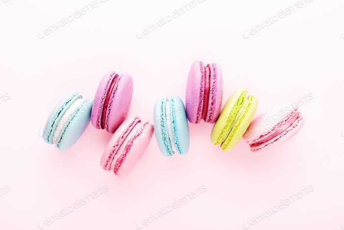 Colorful Macarons on Pink Background.