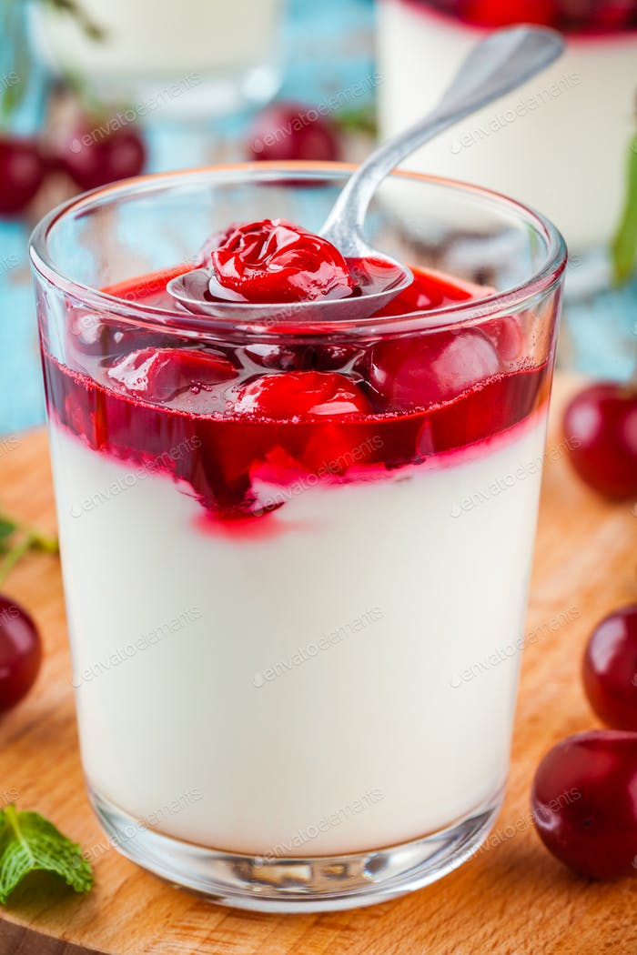 homemade dessert panna cotta with cherry and mint