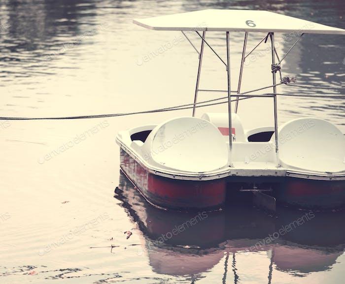Paddle boat in a dark lake