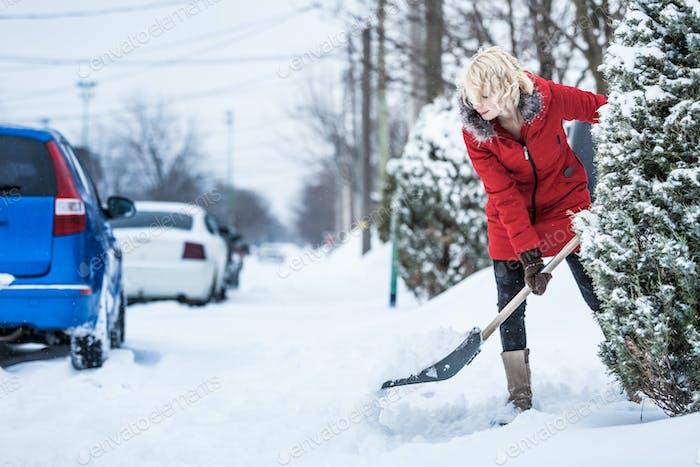 Woman Shoveling her Parking Lot