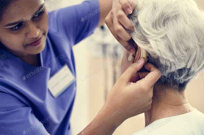 An elderly woman with hearing aid