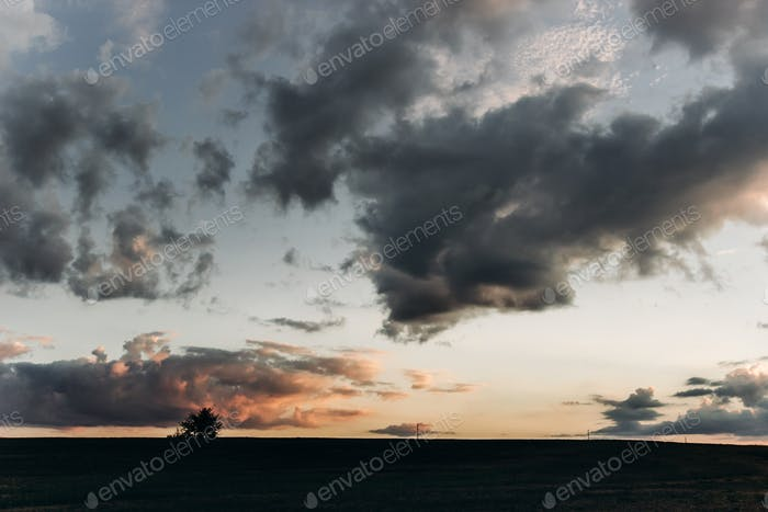 amazing sunset light through clouds in sky in summer