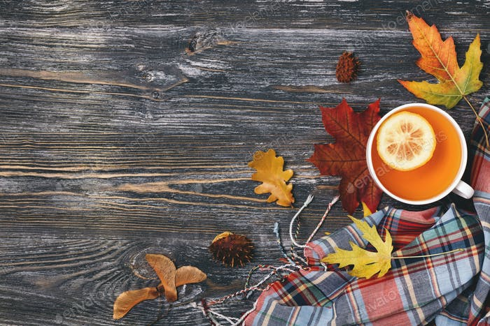 Top View on Cup of Tea with Lemon. Autumn Background.