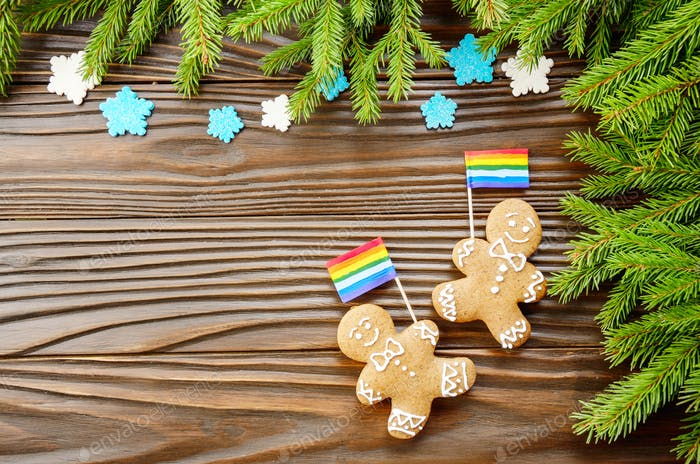 Christmas background of gingerbread man with flag spruce branche