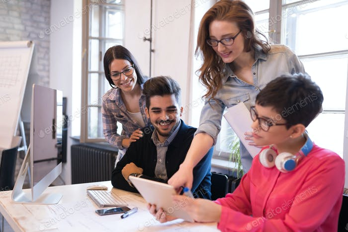 Business coworkers discussing new ideas and brainstorming in office