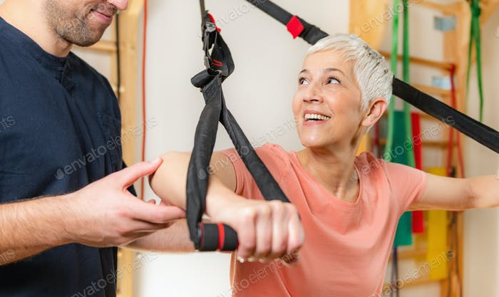 Senior Woman Exercising on TRX