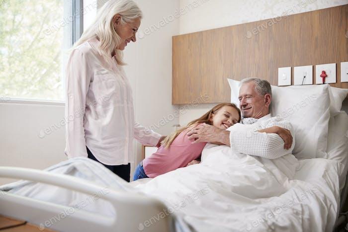 Granddaughter Hugging Grandfather On Family Hospital Visit