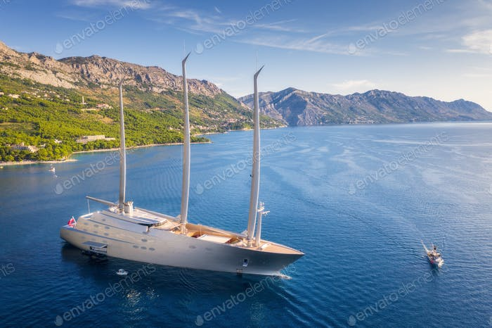 Luxury yacht and blue sea at sunset in summer. Aerial view