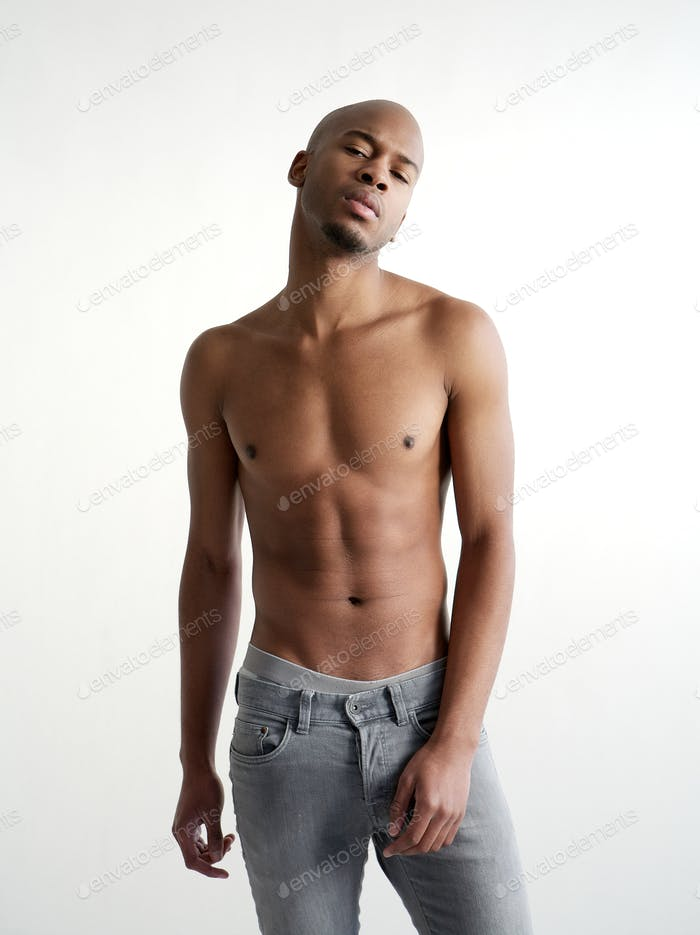 Shirtless black man posing on white background
