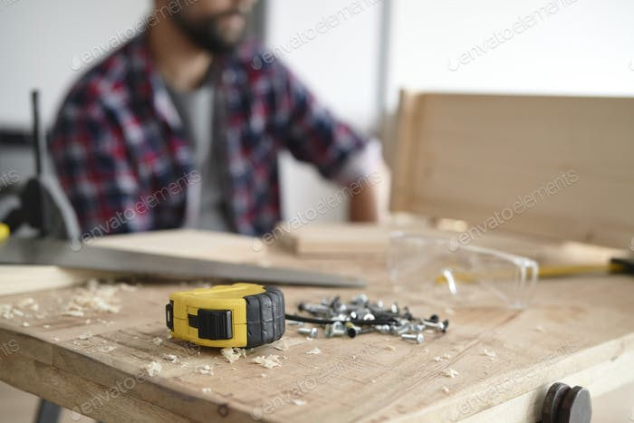 Man at table with DIY tools