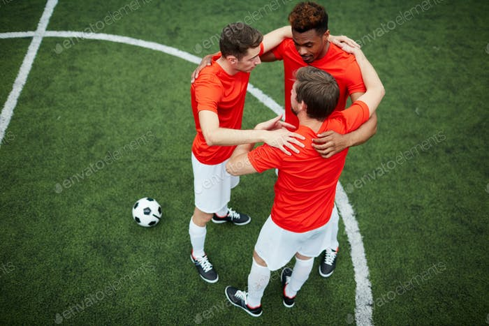 Circle of footballers