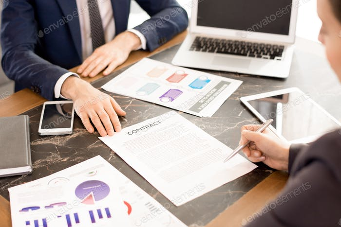 Woman signing contract with financial advisor