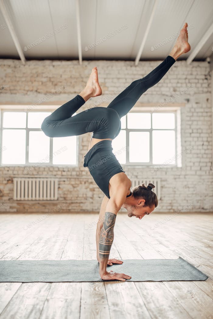 Male yoga standing on hands upside down