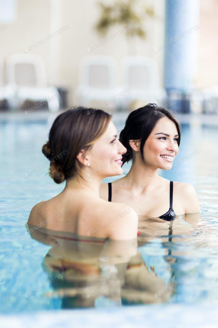 Beautiful young women in a swimming pool