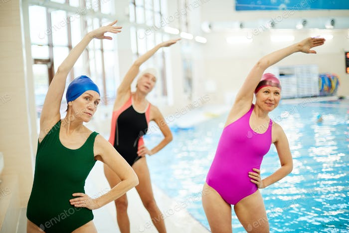 Senior Women Training in Swimming Pool