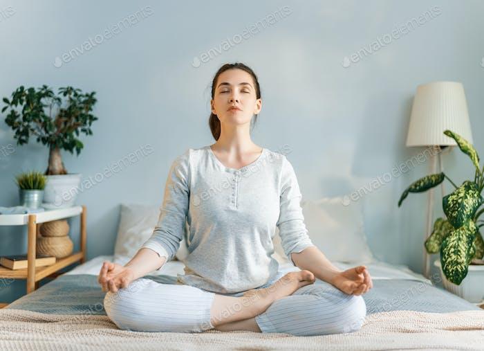 woman enjoying sunny morning and practicing meditation