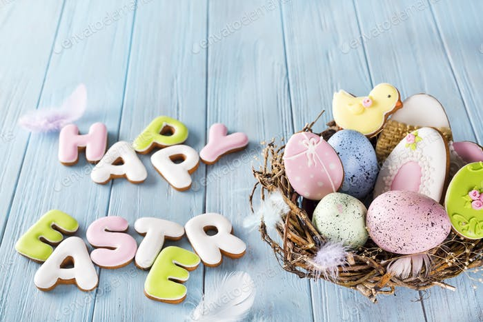 Colorful easter egg end cookies letter Happy Easter in the nest on wood background