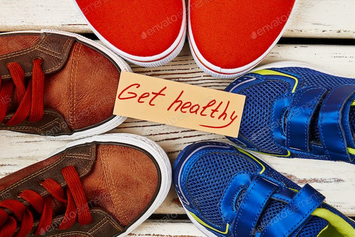 Sport shoes and motivation card