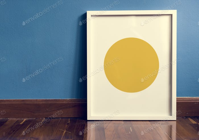 White photo frame against a blue wall