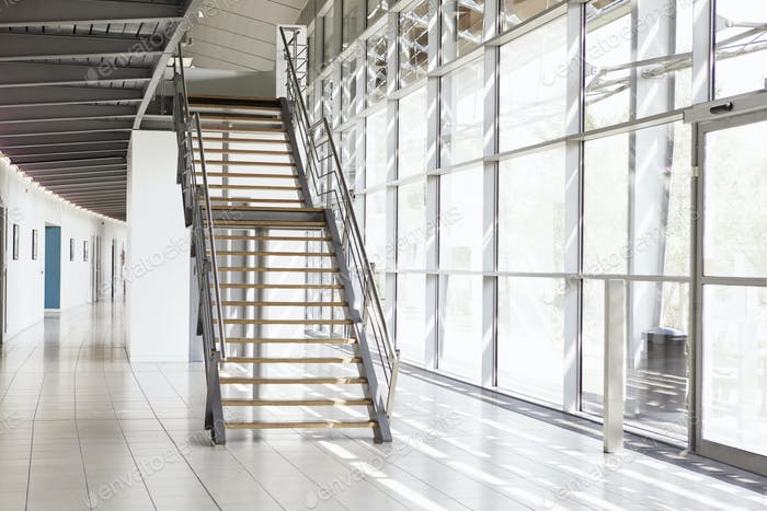 Modern interior of business with glass walls and staircase