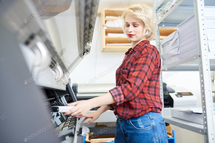 Young Woman Working with Plotter
