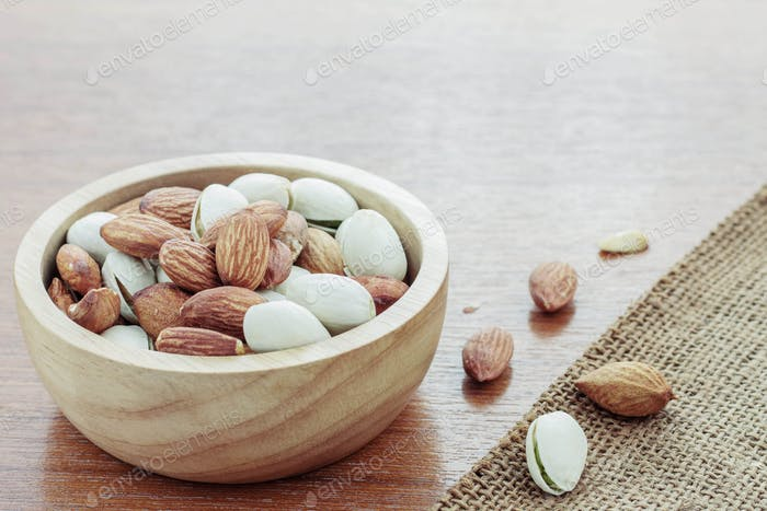Almonds on wooden floor