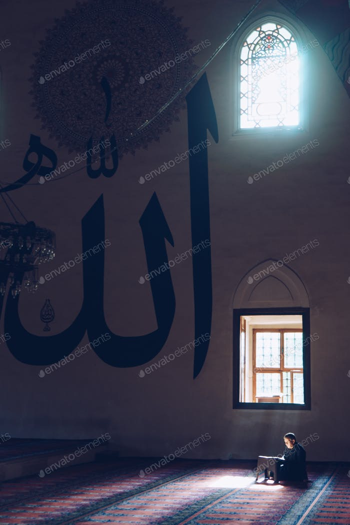 Believer prays in a mosque.