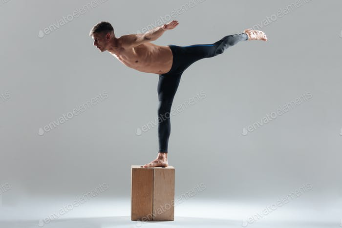 Fitness man doing balance pose