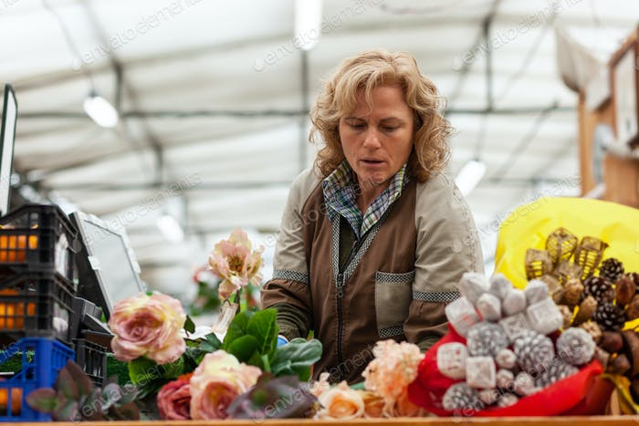 Florist with professional clothing in a nursery.